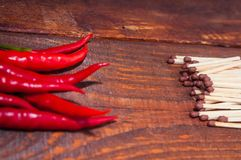 Burning subjects. Hot pepper and matches red, hot, fresh, ingredient, pepper royalty free stock images