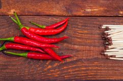 Burning subjects. Hot pepper and matches red, hot, fresh, ingredient, pepper royalty free stock image
