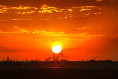 Burning sunrise over silhouette industry Royalty Free Stock Photography