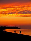 Burning Sunset. A portrait image  of people on the beach during sunset Royalty Free Stock Photography