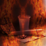 Burning tablets and cup - symbolic representation of drug dependence Royalty Free Stock Photo