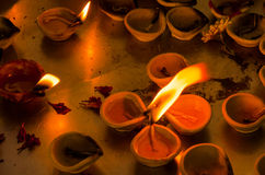 Burning tallow candles in a temple Stock Photography