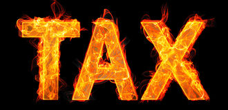 The burning tax letters in business concept Stock Images