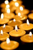 Burning tea candles Stock Images
