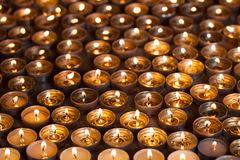 Burning tea light candle flames. Lighted tealight candles spread Stock Photography