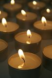 Burning tea light candles Stock Photo