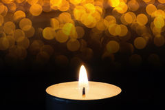 Burning tealight in darkness with bokeh Royalty Free Stock Photography