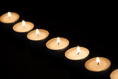 Burning tealights in darkness Royalty Free Stock Photo