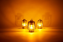 Burning three kerosene lamps background Royalty Free Stock Photography
