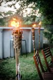 Burning tiki torch in the backyard Stock Image