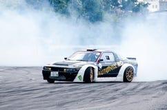 Burning tires sliding stock photography