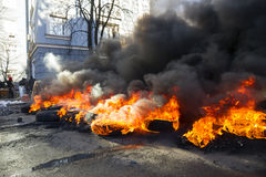 Burning tires in the street Institutska Royalty Free Stock Photography