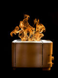 Burning toaster Stock Images