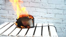 Burning toaster. Toaster with two slices of toast caught on fire over white background. Danger of careless handling of electrical appliances. Fire stock video