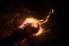 Burning torch in the cold winter. A burning torch is burning and illuminating a cold winter night Stock Photo