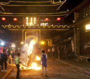 Burning Torch in Front of Chinese Gate Royalty Free Stock Image