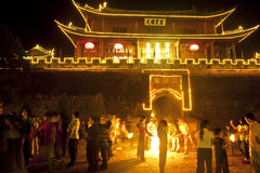Burning Torch in Front of Chinese Gate Royalty Free Stock Images