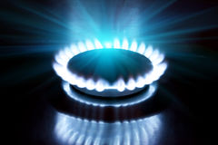 The burning torch on the gas stove Stock Photography