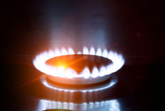 The burning torch on the gas stove Royalty Free Stock Photography
