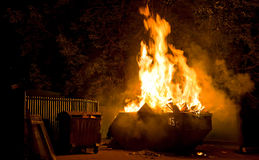 Burning trash container Royalty Free Stock Photo