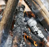 Fire. Closeup of pile of wood burning with flames in the fireplace. Burning tree Bonfire on the grill with smoke. Arson or natural disaster. Bonfire close. Fire stock image