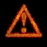 Burning triangle caution sign Royalty Free Stock Photo