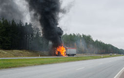 Burning truck on the road Stock Image