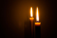 Burning two candles. Image burning candle in dark Royalty Free Stock Photography