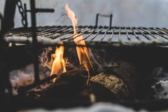 Burning Under Black Metal Grill Stock Images