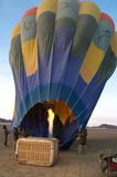 Burning up the balloon. Somewhere in the namib desert a balloon is made ready for takeoff Royalty Free Stock Photos