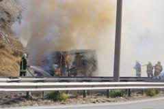Burning van with 4 fireman Royalty Free Stock Photo