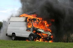 Burning van. With large flames and black smoke royalty free stock photography