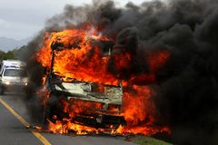 Burning Van with Police car in Background royalty free stock images