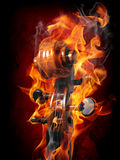 Burning violin scroll Stock Photo