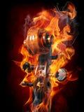 Burning violin scroll Stock Photo