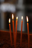 Burning votive candles Stock Image
