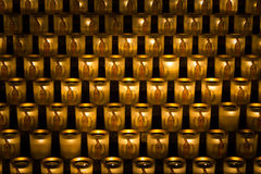 Burning votive candles. Background of burning votive candles in a church, Paris, France Stock Photos