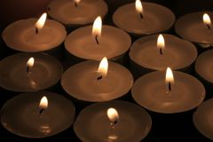 Burning votive lights. Big group of burning votive candles or votive lights stock photography