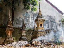 Burning waste at the ossuary at a Buddhist monastery Stock Photography