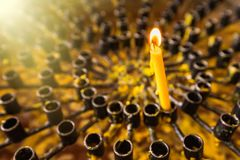 Burning wax candles in a Buddhist temple close-up. Rituals of worship of deities and gods in Asia. Meditation and worship of. Deities in Buddhism royalty free stock photos