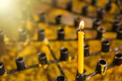 Burning wax candles in a Buddhist temple close-up. Rituals of worship of deities and gods in Asia. Meditation and worship of. Deities in Buddhism royalty free stock images