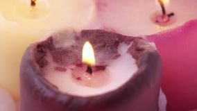 Burning wax candles. Rotation of three burning wax candles stock video
