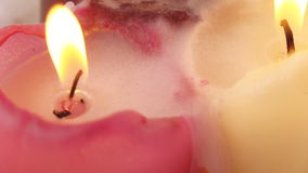 Burning wax candles. Rotation of three burning wax candles stock footage