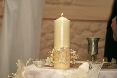 Burning wedding candle at the ceremony Royalty Free Stock Photography