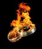 Burning wedding rings Stock Image