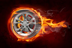 Burning wheel. Wheel in flames on black background Stock Photography