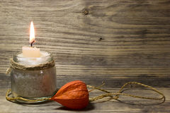 Burning white candle in glass jar Stock Photos