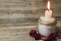 Burning white candle in glass jar Stock Photography