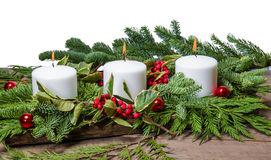 Burning white candles with boughs Royalty Free Stock Image