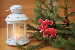 Burning white candles in a Christmas centerpiece deer Royalty Free Stock Images